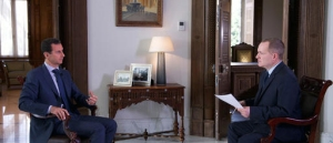 "In this Wednesday, Sept. 21, 2016 photo released by the Syrian Presidency, Syrian President Bashar Assad, left, speaks to Ian Phillips, Vice President, International News for The Associated Press, at the presidential palace in Damascus. Assad said U.S. airstrikes on Syrian troops in the country's east were ""definitely intentional,"" lasting for an hour, and blamed the U.S. for the collapse of a cease-fire deal brokered with Russia. In the interview with the AP, Assad said the war, now in its sixth year, is likely to ""drag on"" because of what he said was continued external support for his opponents. (Syrian Presidency via AP)"